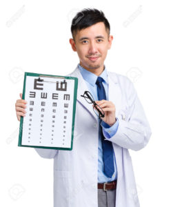 Male oculist holding eye chart and glasses